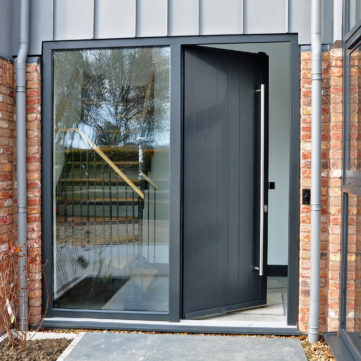 Entrance door with long tube handle