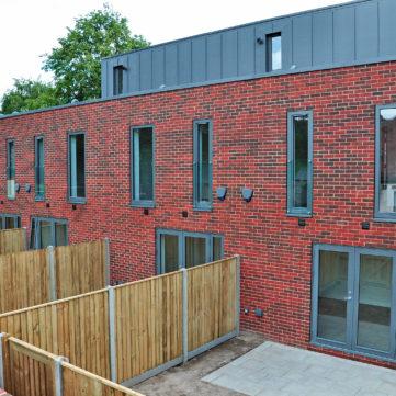 Timber grey windows in red brickwork